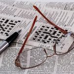 Newspaper with pen and glasses